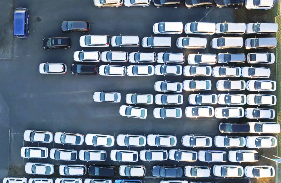 Aerial shot of a car park with parked cars