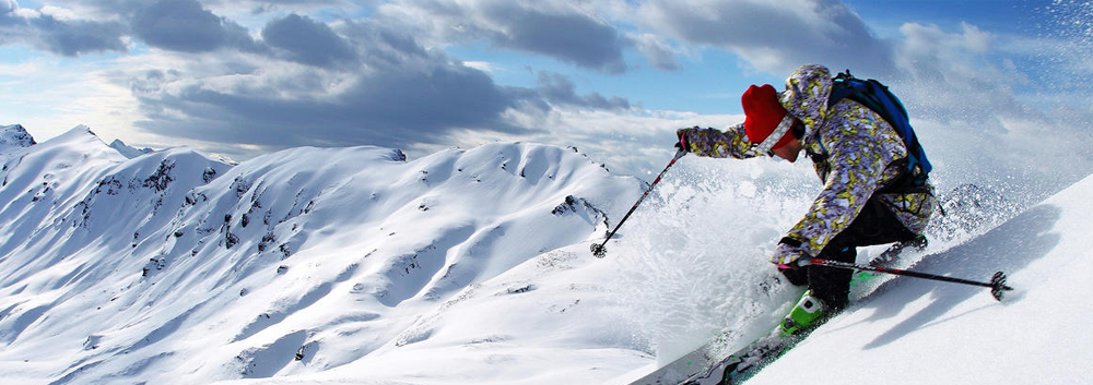 Action shot of person skiing down a mountain