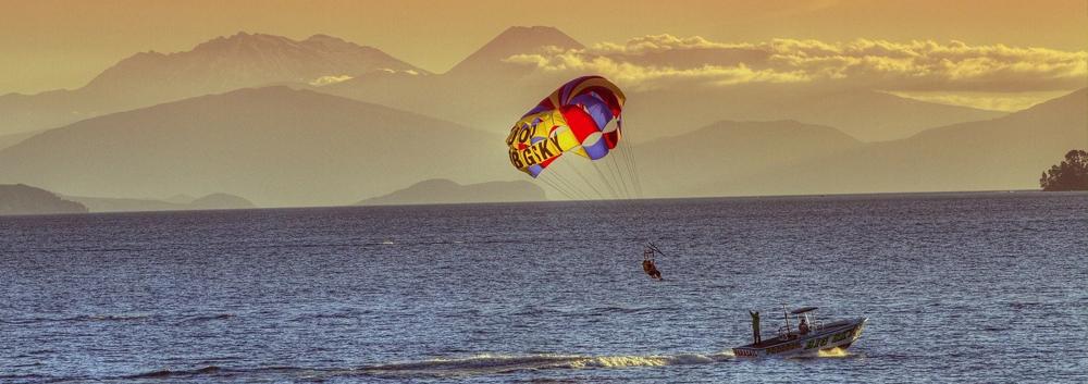 Person para-sailing over lake Taupo