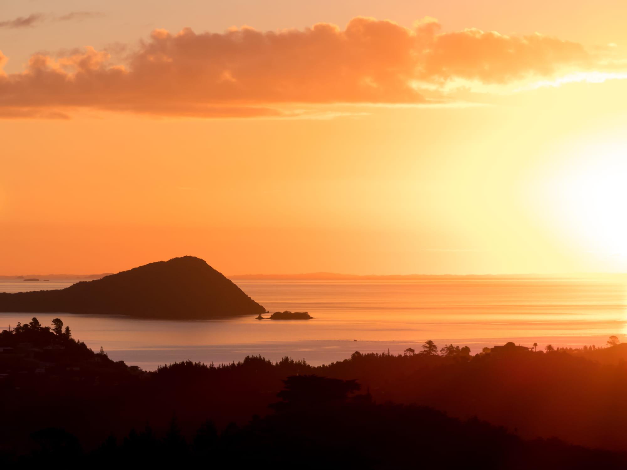 Orange sunset with small island