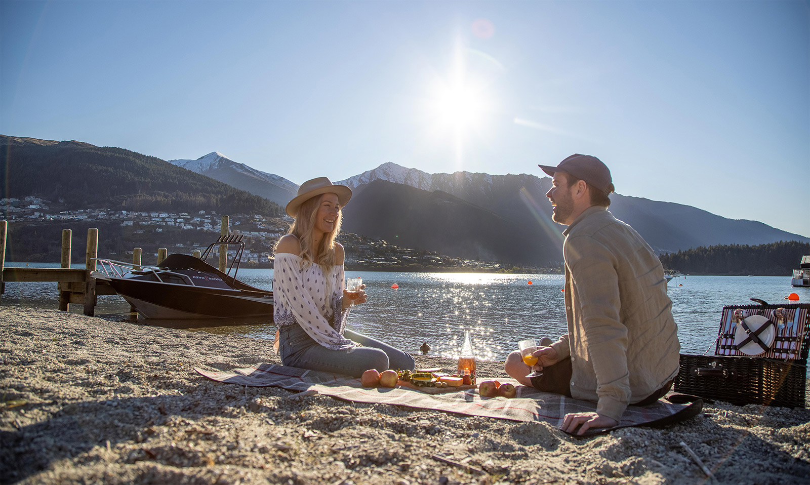 Picnic for a couple on Lake Wakatipu shore