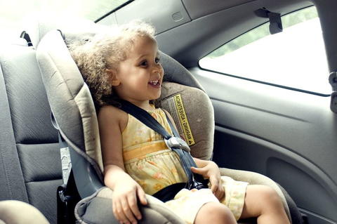 Child in car seat in the back of a car