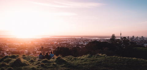 Group of friends watching Auckland city sunset