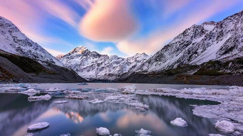 Snow covered mountains with frozen water
