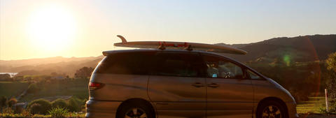 Mode Campervan with a surf board on the roof