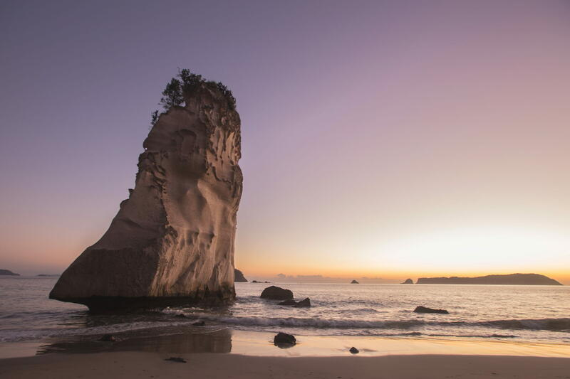 Tall rock formation on a beach