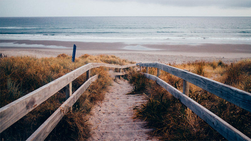 Wooden stairs leading down to beach