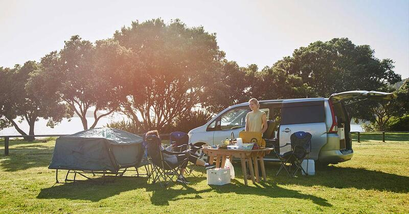 People having a picnic with a Mode Campervan