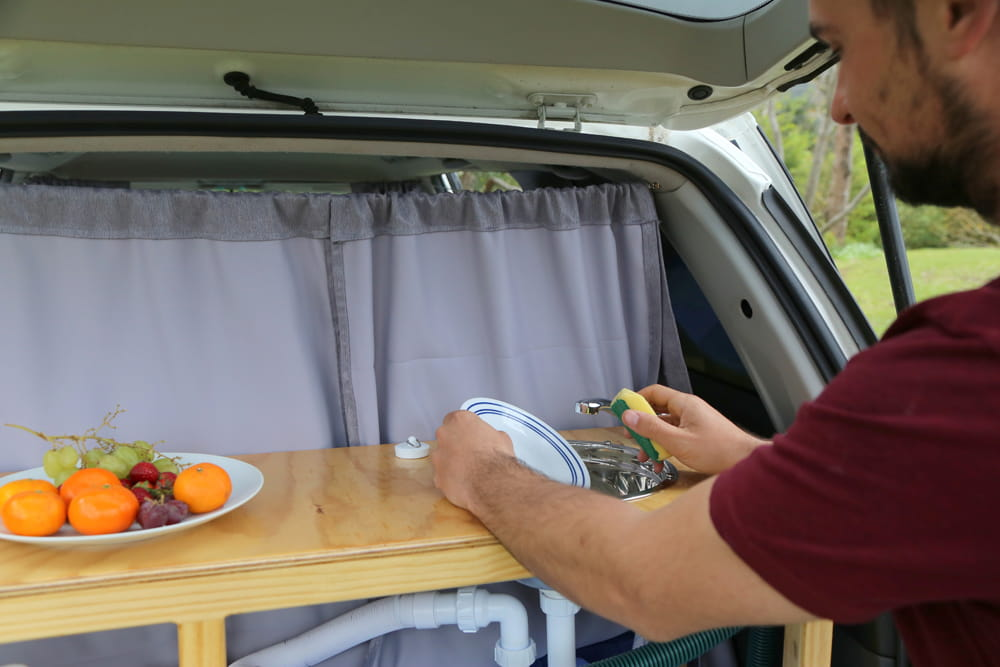 Sink for washing dishes in the boot of Toyota Estima self-contained campervan
